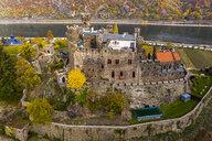 Germany, Rhineland-Palatinate, Trechtingshausen, View of Reichenstein Castle in autumn - AM06354