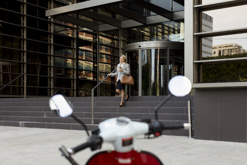 Senior businesswoman leaving office building - MAUF01818