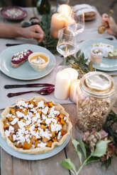Close-up of couple having a romantic candlelight meal outdoors - ALBF00726