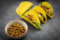 Vegetarian tacos with curcuma, roasted chickpeas, paprika, avocado, salad and red cabbage - LVF07580