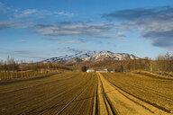 Hokkaido, Little farm before a snow capped mountain near Shiretoko National Park - RUNF00318