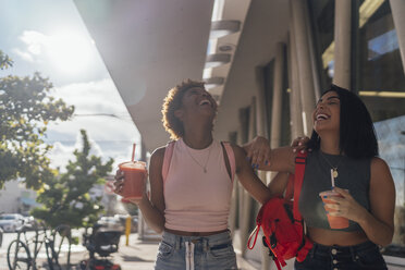 USA, Florida, Miami Beach, two happy female friends having a soft drink in the city - BOYF01162