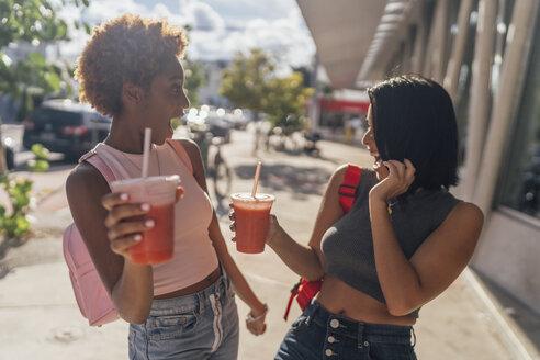 USA, Florida, Miami Beach, two carefree female friends having a soft drink in the city - BOYF01168