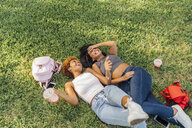 Two carefree female friends relaxing in a park - BOYF01198