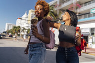 USA, Florida, Miami Beach, two happy female friends with ice cream cones in the city - BOYF01234
