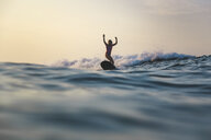 Indonesia, Bali, Batubolong beach, Pregnant woman surfing - KNTF02455