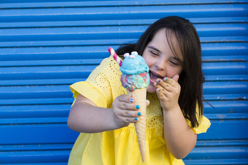 Teenager girl with down syndrome enjoying an ice cream - ERRF00274
