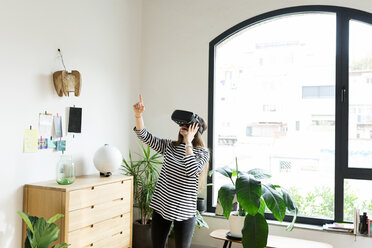 Young woman at home wearing VR glasses - VABF02042
