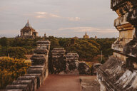 Mid distance view of Thatbyinnyu Temple against cloudy sky during sunset - CAVF58190