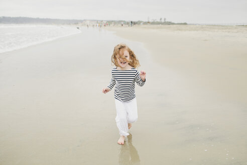 High angle portrait of cheerful girl on shore at beach - CAVF58283