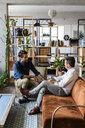 Two businessmen having a discussion in loft office - GIOF04960