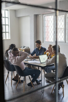 Business team having a meeting in loft office - GIOF04999