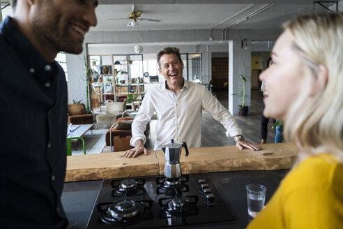 Happy business team having a break in loft office - GIOF05032