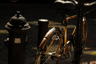 High angle view of a bicycle in ta deserted street in New York City - INGF08730