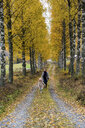 Finland, Kuopio, mother and little daughter strolling together in autumn - PSIF00187