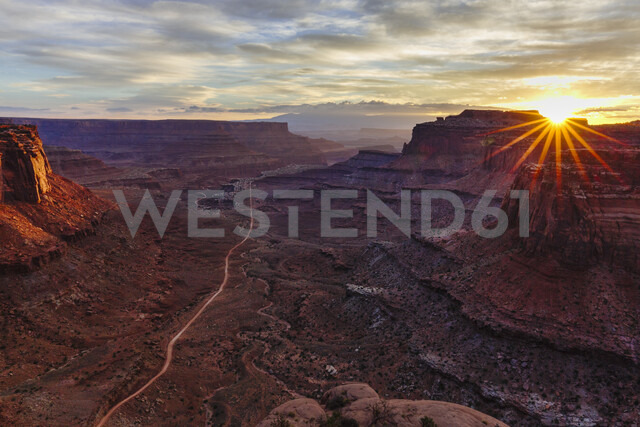 High angle scenic view of rock formations against cloudy sky at Canyonlands National Park during sunrise - CAVF58459