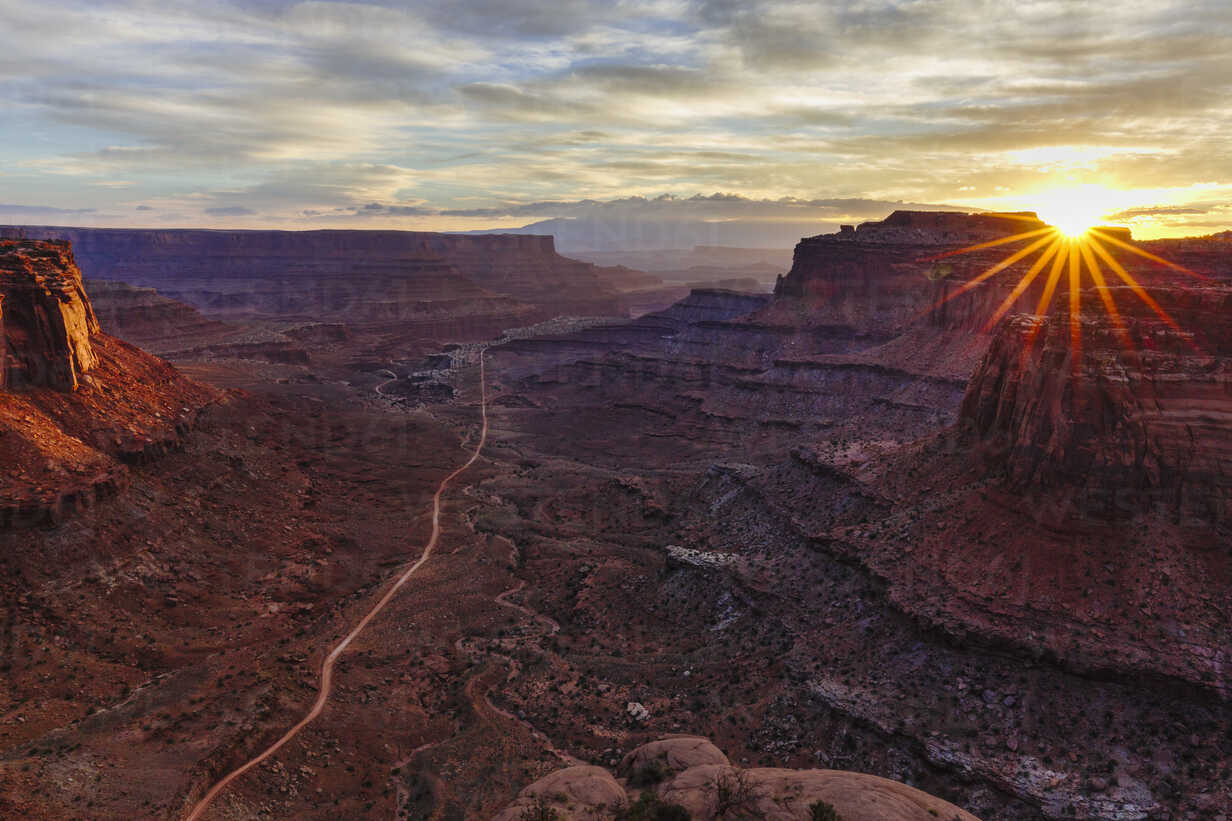 High angle scenic view of rock formations against cloudy sky at Canyonlands National Park during sunrise - CAVF58459 - Cavan Images/Westend61