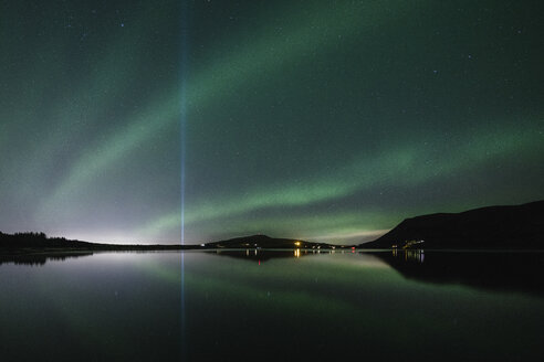 Scenic view of aurora borealis over lake against sky at night - CAVF58711