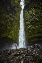 Chile, Patagonia, Osorno Volcano, mother and son standing at Las Cascadas waterfall - SSCF00168