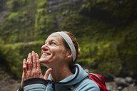 Chile, Patagonia, Osorno Volcano, portrait of woman admiring Las Cascadas waterfall - SSCF00171