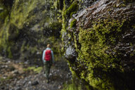 Chile, Patagonia, Osorno Volcano, woman hiking at Las Cascadas waterfall - SSCF00174