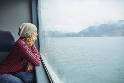 Chile, Hornopiren, woman looking out of window of a ferry - SSCF00198