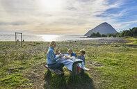 Chile, Chaiten, Carretera Austral, family having picnic at the beach - SSCF00207