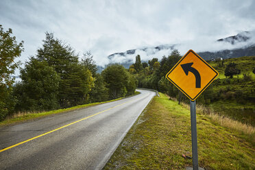 Chile, Puerto Aysen, country road in autumn with curve road sign - SSCF00225