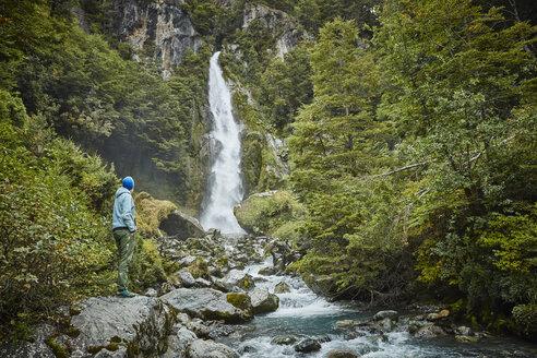 Chile, Laguna San Rafael National Park, woman admiring Las Cascadas waterfall - SSCF00240