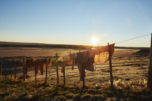 Chile, Tierra del Fuego, clothes hanging out to dry on a clothesline of an Estancia - SSCF00273