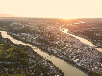 Germany, Bavaria, Passau, City of three rivers, Aerial view, Danube and Inn river, Veste Oberhaus and Maria Hilf at sunset - JUNF01569
