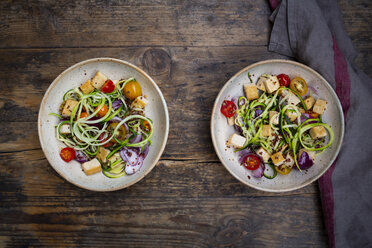 Two bowls of zoodles with fried tofu, red quinoa, red onions and tomatoes - LVF07588