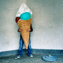 Man holding huge fake ice-cream - INGF09072