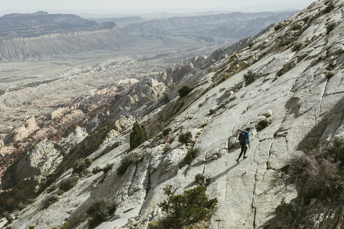 High angle view of hiker walking on mountain against sky - CAVF59636