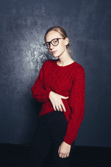 A stylish young female student wearing glasses and a red sweater - INGF09345