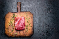 Directly above shot of tuna on a wooden chopping board - INGF09468
