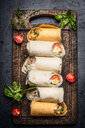 High angle view of healthy vegetable wraps on a table - INGF09684