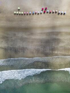 Bali, Kuta Beach, three beach umbrellas, aerial view - KNTF02512