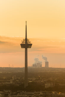 Germany, Cologne, silhouette of  television tower at dawn - SKAF00072