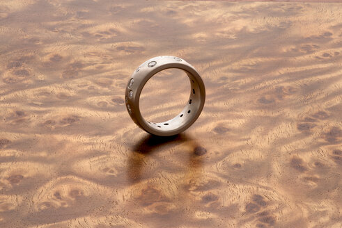 Silver ring on Mandora wood grain - SKAF00078