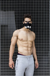 Young man with training mask during workout - MAUF01882