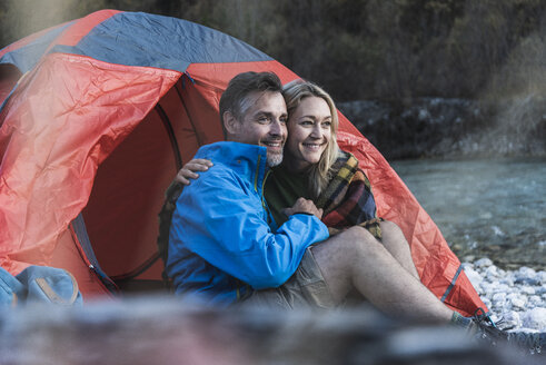 Mature couple camping at riverside - UUF16324
