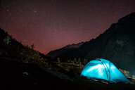 A camp tent by a mountain under the stars - INGF10033