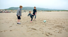 A family playing football on the beach - INGF10078