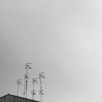Low angle view of communications tower in the fog - INGF10361