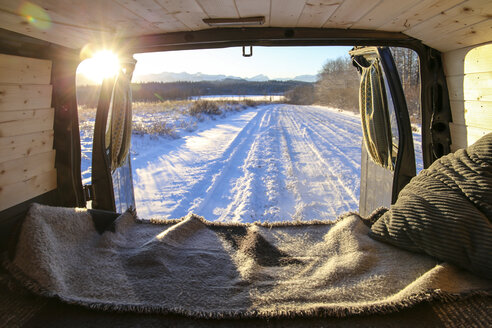Snow covered landscape seen through vehicle during sunset - CAVF60179