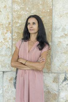 Portrait of mature woman wearing pink summer dress - JUNF01574