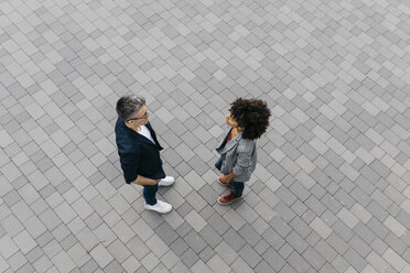 Top view of two colleagues talking on a square - JRFF02213