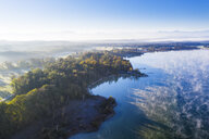 Germany, Bavaria, Upper Bavaria, Fuenfseenland, St. Heinrich near Muensing, Aerial view of Lake Starnberg and morning fog - SIEF08215