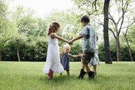 Siblings playing on field - CAVF60540